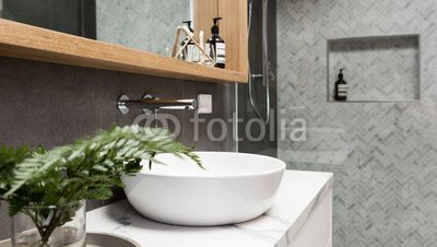 Bathroom-details-clean-white-basin-with-shower-tiling-behind.jpg
